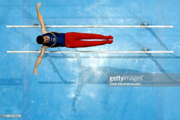 Artur Davtyan of Armenia competes on the Parallel bars during the Artistic Gymnastics Men's AllAround Finals event during Day nine of the 2nd...