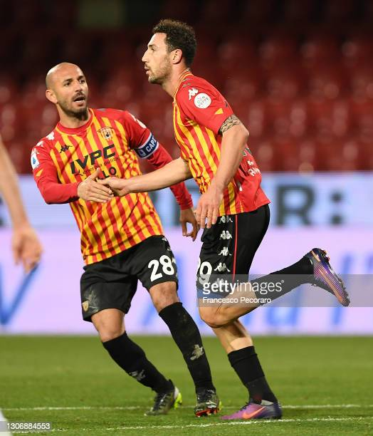 Artur Ionita of Benevento Calcio celebrates with teammate Pasquale Schiattarella after scoring their team's first goal during the Serie A match...