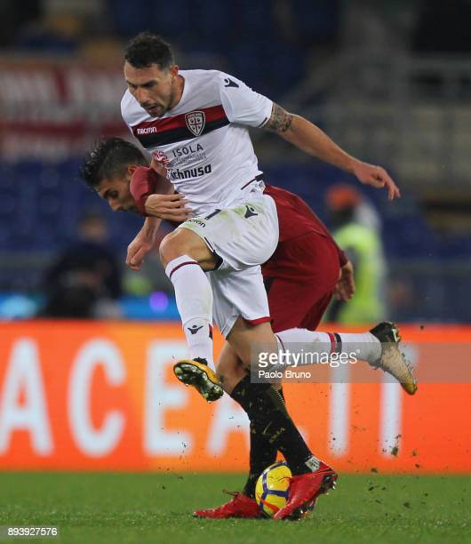 Artur Ionita of Cagliari Calcio competes for the ball with Lorenzo Pellegrini of AS Roma during the Serie A match between AS Roma and Cagliari Calcio...