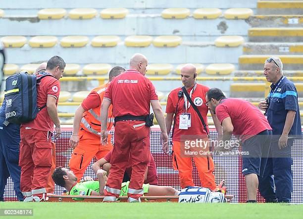 Artur Ionita of Cagliari Calcio is stretchered off the field during the Serie a match between Bologna FC and Cagliari Calcio at Stadio Renato...