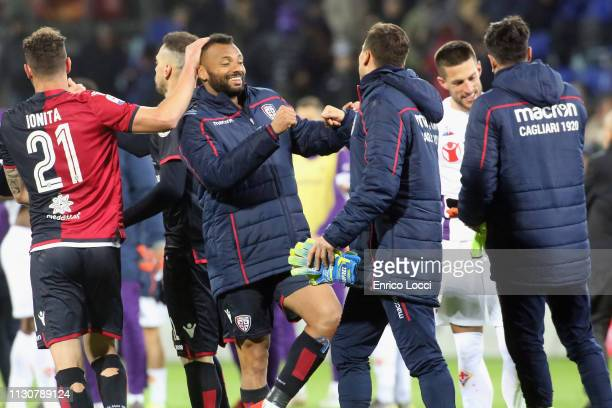 Artur Ionita of Cagliari celebrates a victory at the end of during the Serie A match between Cagliari and ACF Fiorentina at Sardegna Arena on March...