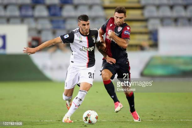 Artur Ionita of Cagliari in contrast during the Serie A match between Cagliari Calcio and Juventus at Sardegna Arena on July 29, 2020 in Cagliari,...