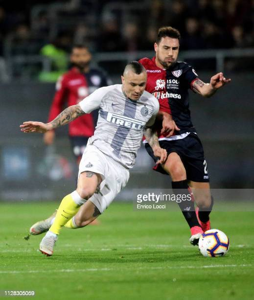 Artur Ionita of Cagliari in contrast with Radja Nainggolan of Inter during the Serie A match between Cagliari and FC Internazionale at Sardegna Arena...