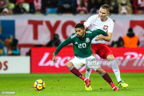 Artur Jedrzejczyk Javier Aquino during the International Friendly match between Poland and Mexico at Energa Stadium in Gdansk Poland on November 13...