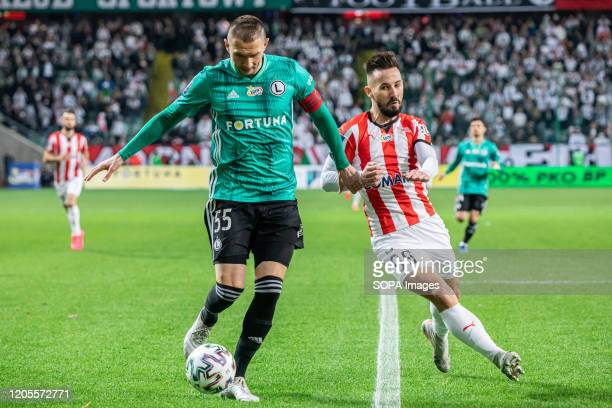 Artur Jedrzejczyk of Legia Warszawa and Tomas Vestenicky of Cracovia are seen in action during the PKO Ekstraklasa League match between Legia...