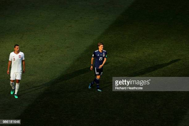 Artur Jedrzejczyk of Poland and Gotoku Sakai of Japan look on during the 2018 FIFA World Cup Russia group H match between Japan and Poland at...