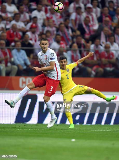 Artur Jedrzejczyk of Poland and Romario Benzar of Romania in action during the 2018 FIFA World Cup Russia eliminations match between Poland and...