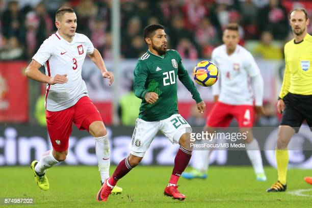 Artur Jedrzejczyk of Poland Javier Aquino of Mexico during the international friendly match between Poland and Mexico on November 13 2017 in Gdansk...