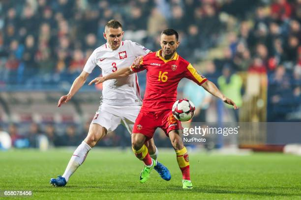 Artur Jedrzejczyk of Poland vies Damir Kojasevic of Montenegro during the FIFA World Cup 2018 qualification football match between Montenegro and...