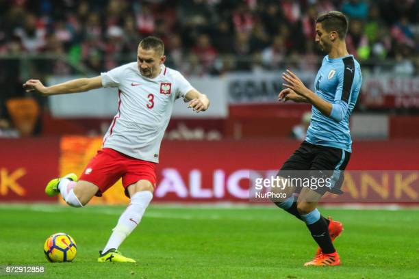 Artur Jedrzejczyk Rodrigo Bentancur in action during the international friendly match between Poland and Uruguay at National Stadium on November 10...