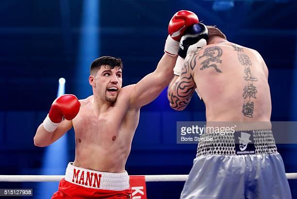 Artur Mann of Germany exchanges punches with Bjoern Blaschke of Germany during their cruiserweight fight at Jahnsportforum on March 12 2016 in...