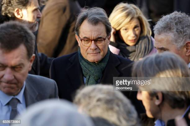 Artur Mas, former Catalan president, center, arrives at the Catalan high court in Barcelona, Spain, on Monday, Feb. 6, 2017. Mas is accused of...
