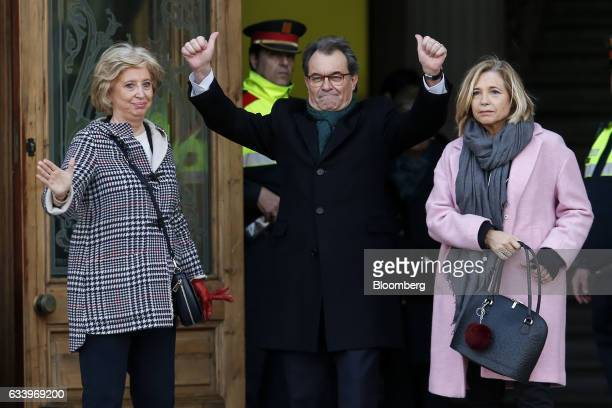 Artur Mas, former Catalan president, center, Irene Rigau, former Catalan education minister, left, and Joana Ortega, former Catalan vice president,...