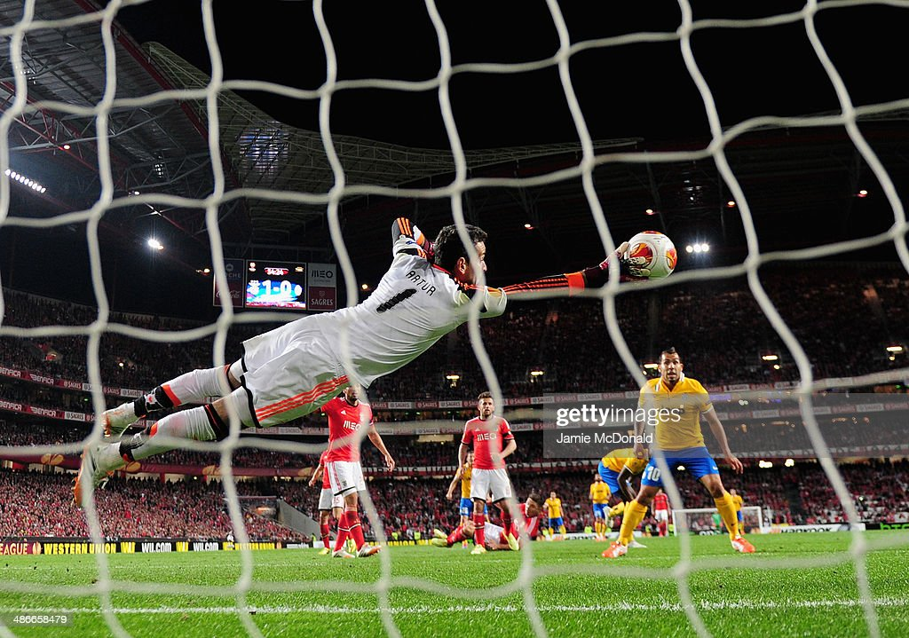 Artur of Benfica saves a shot from Carlos Tevez of Juventus during the UEFA Europa League Semi Final between SL Benfica and Juventus at Estadio da Luz on April 24, 2014 in Lisbon, Portugal.