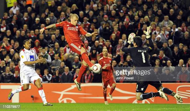 Artur of Braga saves the shot from Martin Skrtel of Liverpool during the UEFA Europa League round of 16 second leg match between Liverpool and Braga...