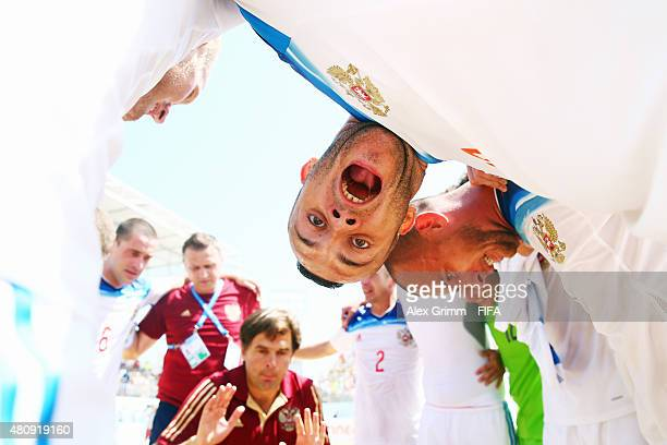 Artur Paporotnyi of Russia and team mates celebrate after the FIFA Beach Soccer World Cup Portugal 2015 Quarter-final match between Brazil and Russia...
