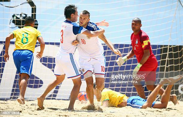 Artur Paporotnyi of Russia celebrates his team's first goal with team mate Kirill Romanov during the FIFA Beach Soccer World Cup Portugal 2015...