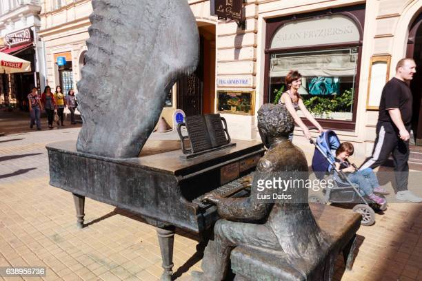 artur rubinstein statue at piotrkowska street, lodz - life size stock pictures, royalty-free photos & images