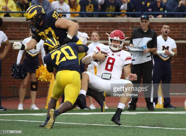 Artur Sitkowski of the Rutgers Scarlet Knights is stopped on a fourth down run by Aidan Hutchinson and Brad Hawkins of the Michigan Wolverines at...