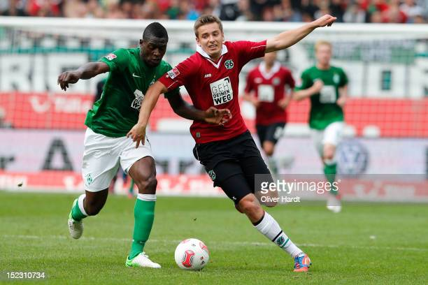 Artur Sobiech of Hannover and Assani Lukimya of Bremen battle for the ball during the 1 Bundesliga match between Hannover 96 and Werder Bremen at AWD...
