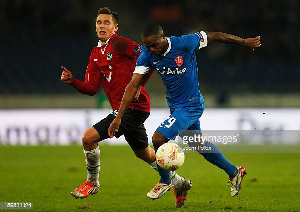 Artur Sobiech of Hannover and Edson Braafheid of Twente compete for the ball during the UEFA Europa League Group L match between Hannover 96 and FC...