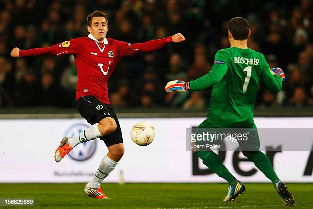 Artur Sobiech of Hannover and Sander Boschker of Twente compete for the ball during the UEFA Europa League Group L match between Hannover 96 and FC...