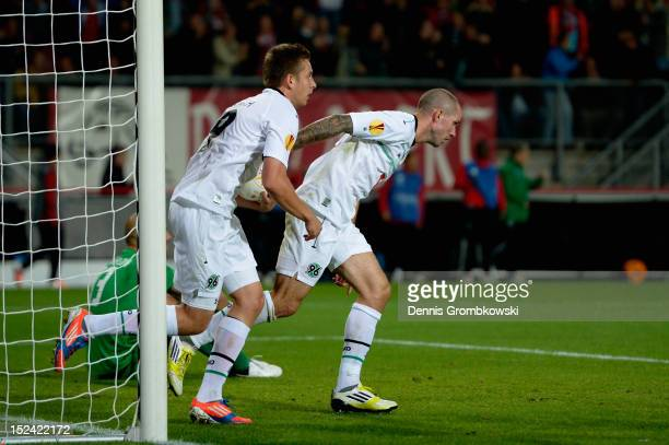 Artur Sobiech of Hannover and teammate Leon Andreasen celebrate after their team's first goal during the UEFA Europa League Group L match between...