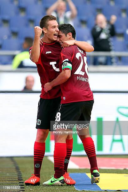 Artur Sobiech of Hannover celebrates with team-mate Lars Stindl after scoring their teams second goal during the Bundesliga match between Hannover 96...