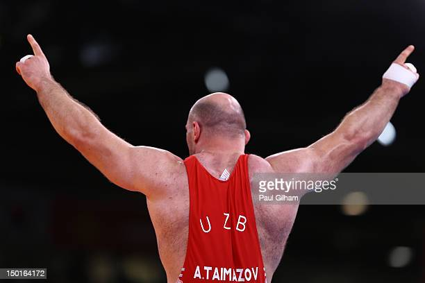 Artur Taymazov of Uzbekistan celebrates a gold medal in the Men's Freestyle 120 kg Wrestling on Day 15 of the London 2012 Olympic Games at ExCeL on...