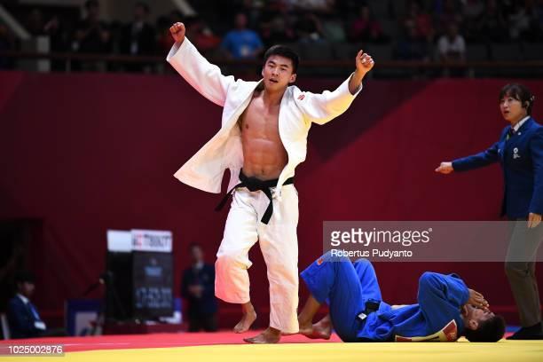 Artur Te of Kyrgyzstan celebrates victory after beating Shakhram Akhadov of Uzbekistan during Men's Judo -66kg Bronze contests at JCC Plenary Hall on...