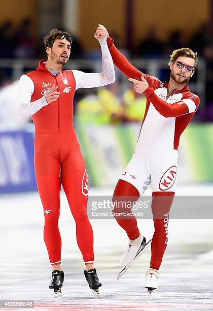 Artur Was of Poland celebrates with Laurent Dubreuil of Canada after the Men'S 500m Division A competition during Day 3 of the Essent ISU World Cup...