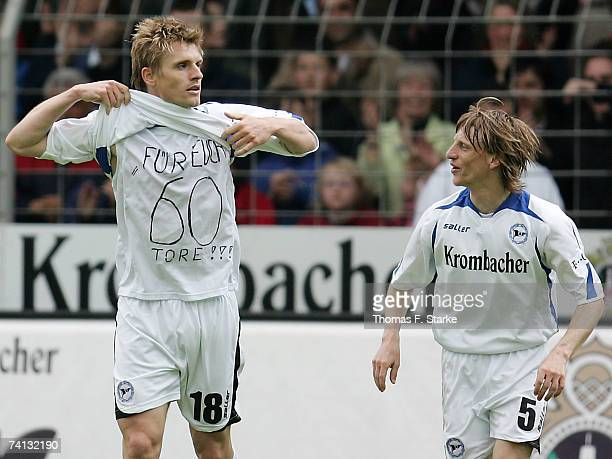 Artur Wichniarek and Ruediger Kauf of Bielefeld celebrate during the Bundesliga match between Arminia Bielefeld and Hanover 96 at the Schuco Arena on...