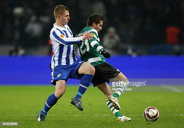 Artur Wichniarek of Berlin battles for the ball with Joao Moutinho of Lissabon during the UEFA Europa League match between Hertha BSC Berlin and...