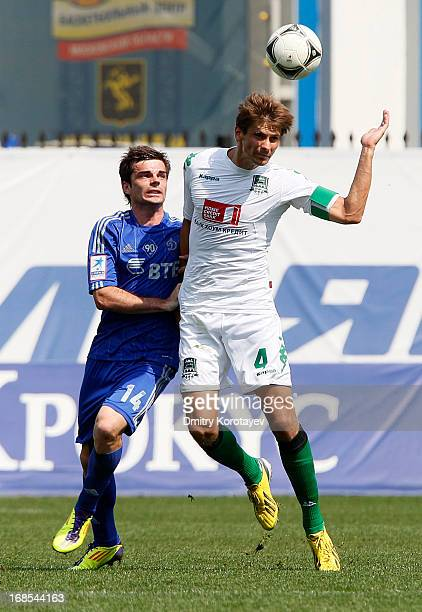 Artur Yusupov of FC Dynamo Moscow is challenged by Alyaksandr Martynovich of FC Krasnodar during the Russian Premier League match between FC Dynamo...