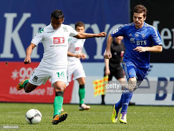 Artur Yusupov of FC Dynamo Moscow is challenged by Wanderson of FC Krasnodar during the Russian Premier League match between FC Dynamo Moscow and FC...