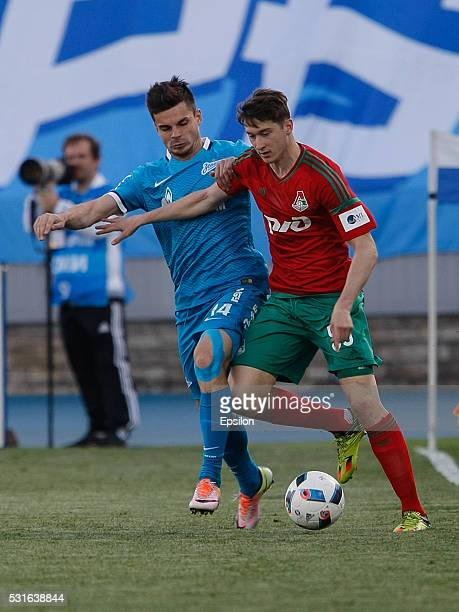 Artur Yusupov of FC Zenit St Petersburg and Aleksei Miranchuk of FC Lokomotiv Moscow vie for the ball during the Russian Football League match...
