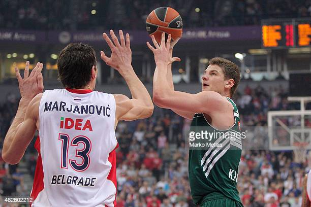 Arturas Gudaitis, #7 of Zalgiris Kaunas competes with Boban Marjanovic, #13 of Crvena Zvezda Telekom Belgrade during the Euroleague Basketball Top 16...