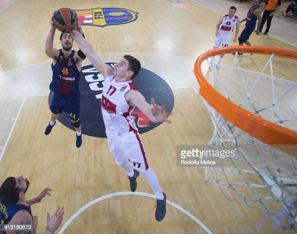 Arturas Gudaitis #77 of AX Armani Exchange Olimpia Milan competes with Ante Tomic #44 of FC Barcelona Lassa during the 2017/2018 Turkish Airlines...