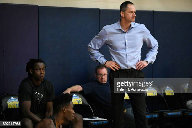 Arturas Karnisovas General Manager for the Denver Nuggets watches potential draft picks during a predraft workout for NBA hopefuls at the practice...