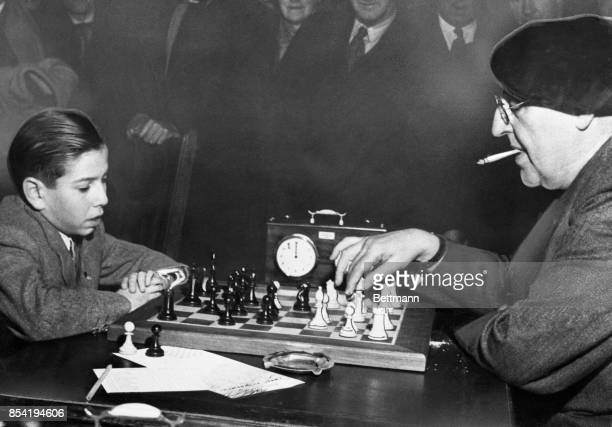 Arturito Pomar of Madrid is only 14 but he can hold his own at chess with the best of them His opponent here is Dr Ossip Bernstein the oldest Russian...