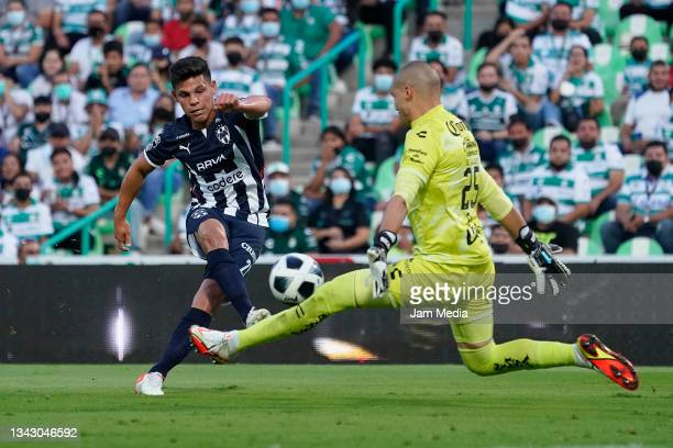 Arturo Alfonso Gonzalez of Monterrey fights for the ball with Manuel Gibran Lajud goalkeeper of Santos during the 10th round match between Santos...