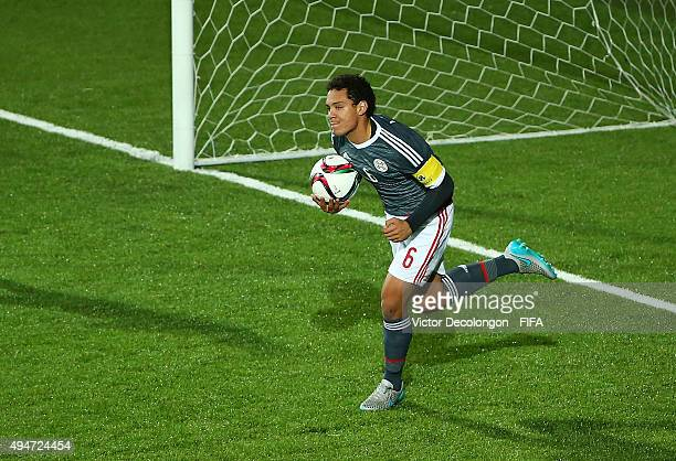 Arturo Aranda of Paraguay runs with the ball toward midfield after scoring on a penalty kick against goalkeeper Luca Zidane of France during the...