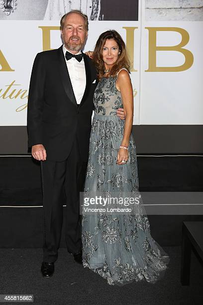Arturo Artom and Alessandra Repini attend the amfAR Milano 2014 Cocktail as part of Milan Fashion Week Womenswear Spring/Summer 2015 on September 20...