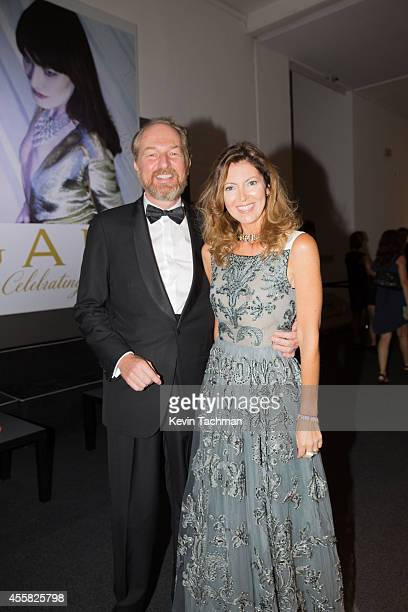 Arturo Artom and Alessandra Repini attend the amfAR Milano 2014 cocktail party as part of Milan Fashion Week Womenswear Spring/Summer 2015 on...