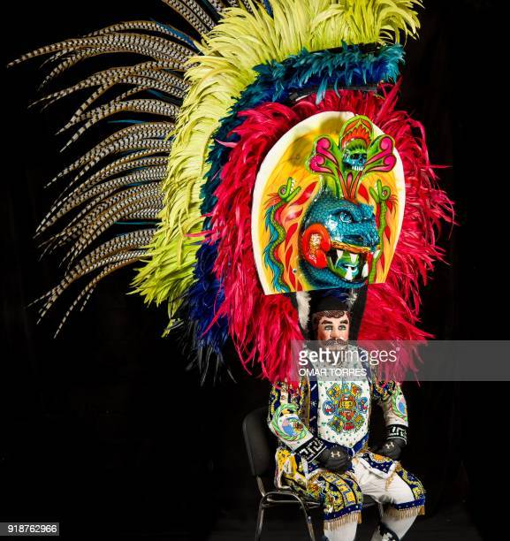 Arturo Beristain poses in his costume for the carnival in Tlaxcala Mexico on February 13 2018 The satirical costumes and masks were originally...