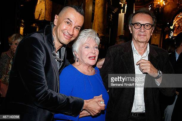 Arturo Brachetti Line Renaud and Bertrand de Labbey attend the Line Renaud and Stromae waxwork unveiling at Musee Grevin on October 12 2014 in Paris...