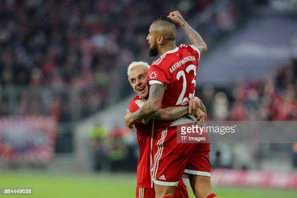 Arturo Erasmo Vidal of Bayern Muenchen celebrates after scoring his team`s first goal with Rafinha of Bayern Muenchen during the Bundesliga match...
