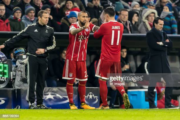 Arturo Erasmo Vidal of Bayern Muenchen comes on as a substitute for James Rodriguez of Bayern Muenchen during the UEFA Champions League group B match...