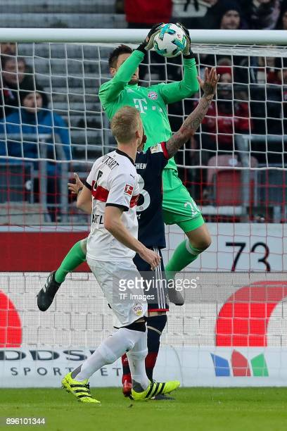 Arturo Erasmo Vidal of Bayern Muenchen Goalkeeper Sven Ulreich of Bayern Muenchen and Timo Baumgartl of Stuttgart battle for the ball during the...