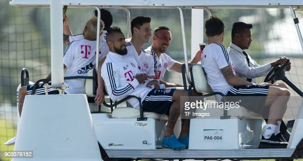 Arturo Erasmo Vidal of Muenchen Marco Friedl of Muenchen Franck Ribery of Muenchen and Javier Martinez of Muenchen drive in a golf cart during the FC...